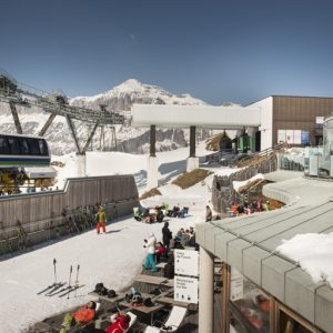 People relaxing at the sun in the terrrace of Rifugio Cesa da Fuoch at Porta Vescovo Dolomiti Resort,Arabba